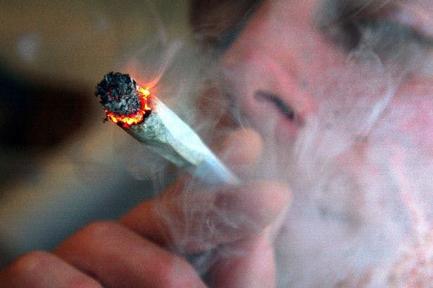 An unidentified man smokes a cannabis cigarette What The Newest Study Says About Teenage Marijuana Consumption And Future Health Risks