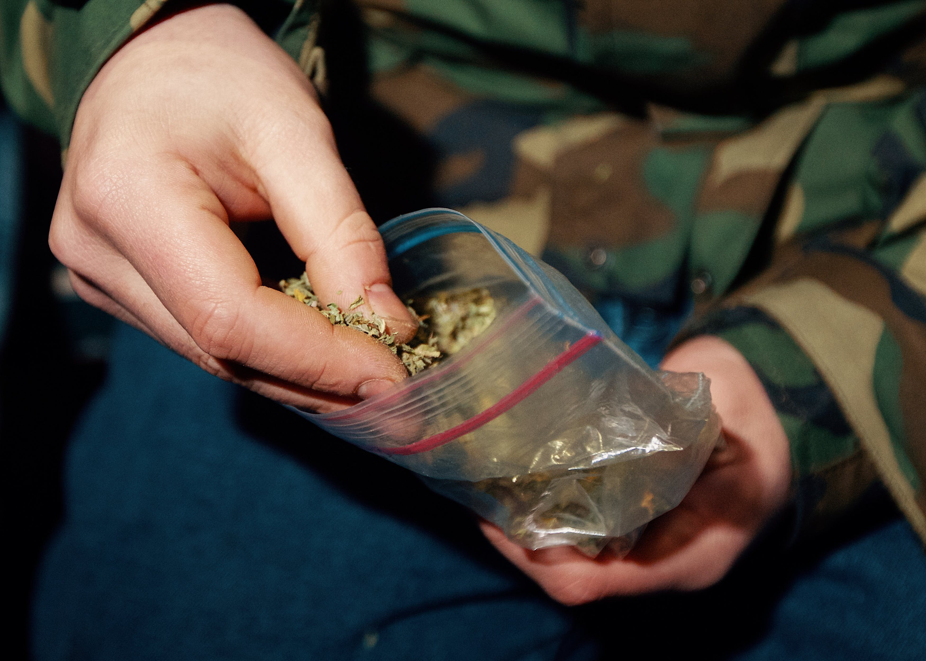 In this article, we explore laced weed. Here, a man pulls nugs out of a ziplock