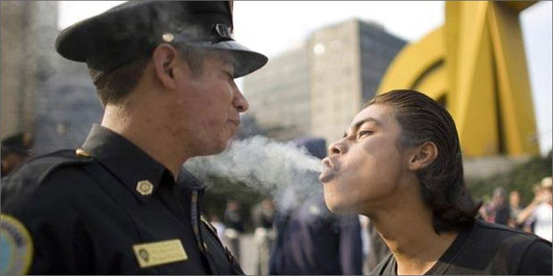 2 police officer running dispensary blow smoke Michigan Govenor Takes Initiative With State Medical Progam