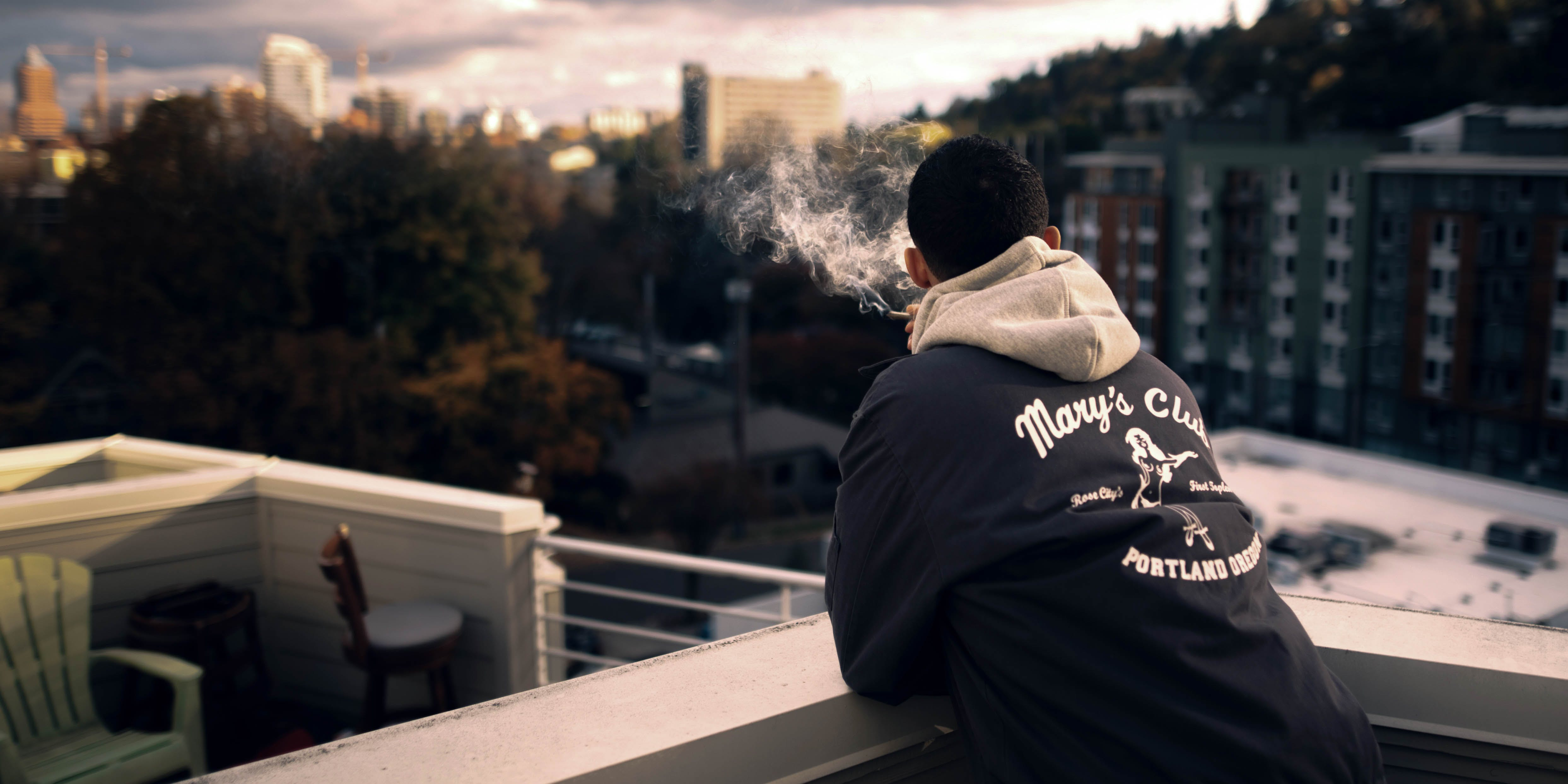 Someone smokes on a rooftop. Can CBD help with depression?
