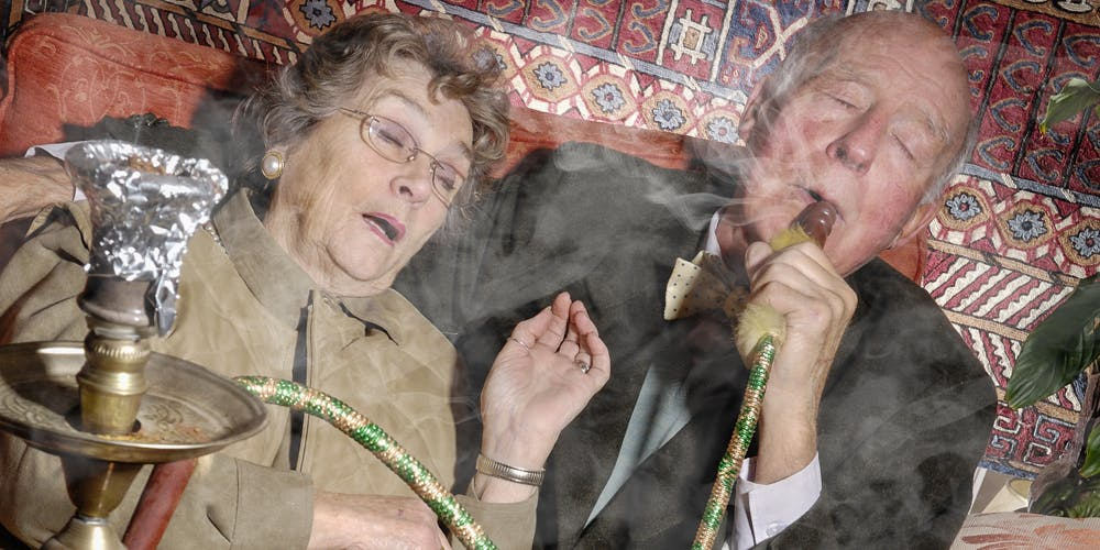 Senior couple smoking hookah pipe to smoke weed
