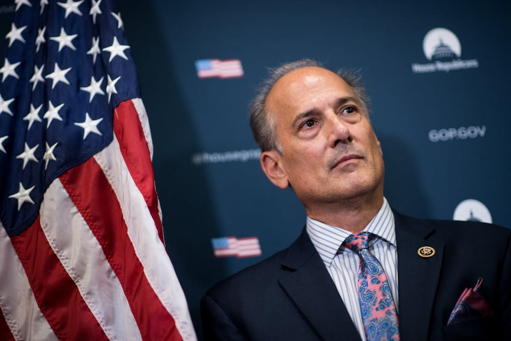 Rep. Tom Marino stands in front of an american flag, recently he just withdrew after a damning opioid report