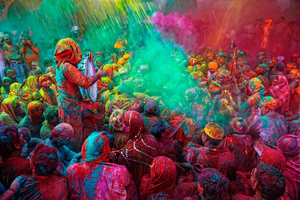 Holi Festival Celebrations where people sing bhajans of Radha and Lord Krishna on in Mathura, India