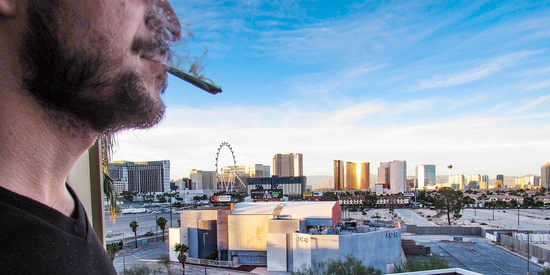 man smoking joint infant of Nevada casino