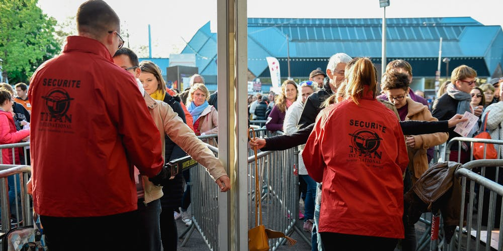 """Security staff control festival goers at the 41th edition of """"Le Printemps de Bourges"""" rock and pop music festival"""
