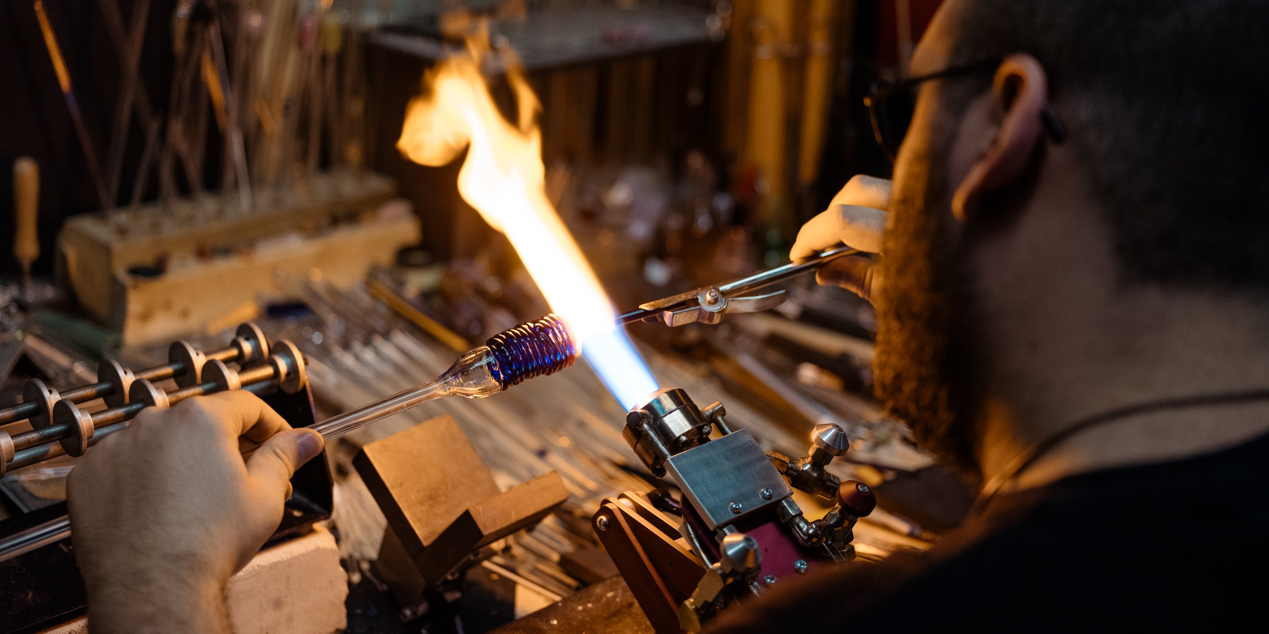A glass blower from toronto flameworks teaches you how to make a bong