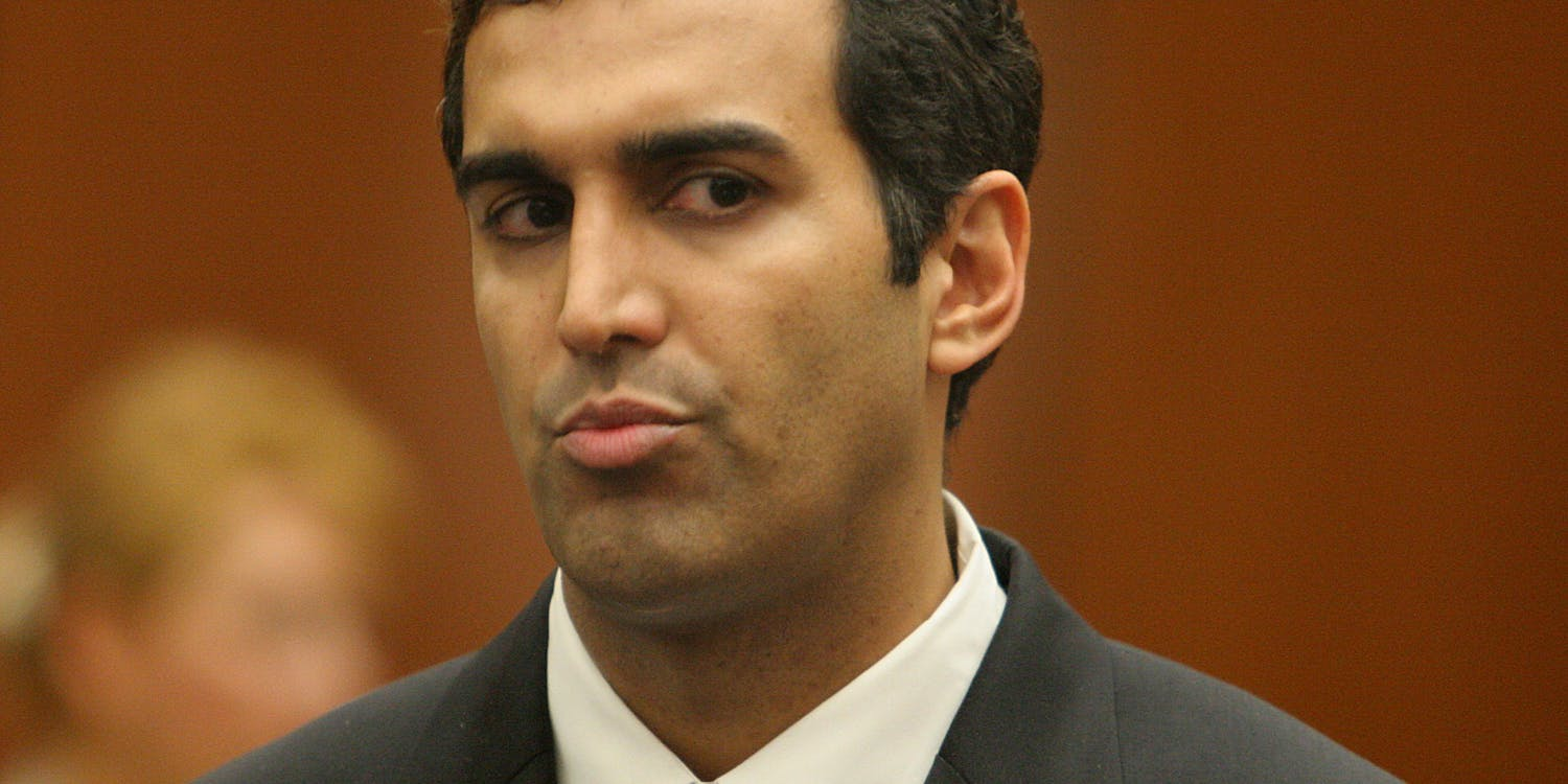 Dr. Sandeep Kapoor listens during arraignment in connection with supplying perscription drugs to An