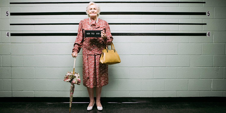 cute old woman getting mugshot taken