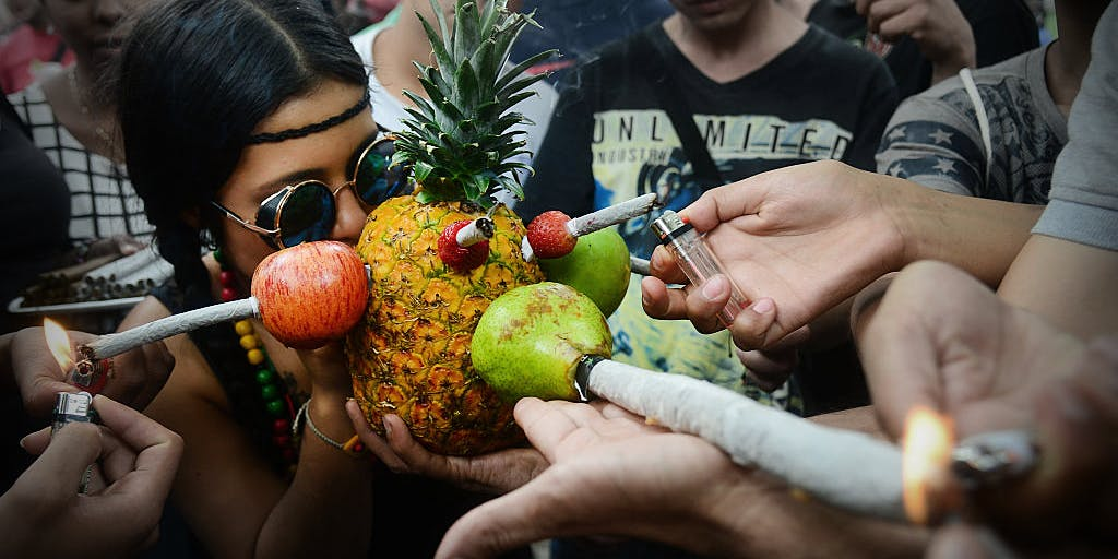 Woman smoking cannabis through various fruits and joints