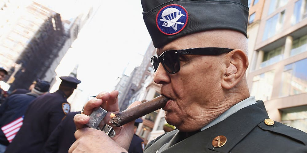 Veteran lights up a cigar at Veteran Day Parade NYC