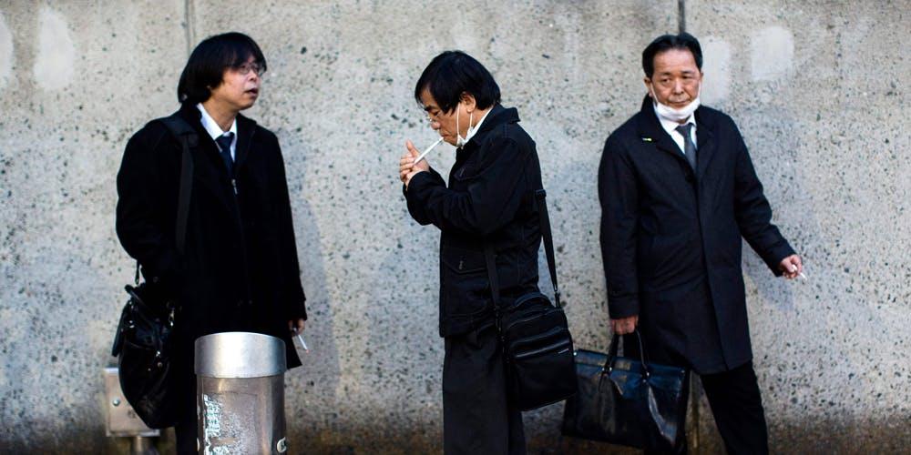 Group of Japanese Men taking a smoke break