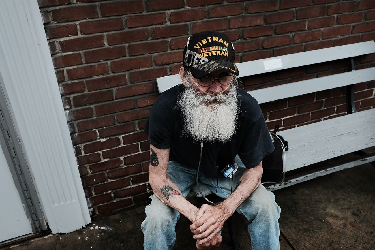 a Vietnam veteran, pauses downtown in the struggling city of Williamsport