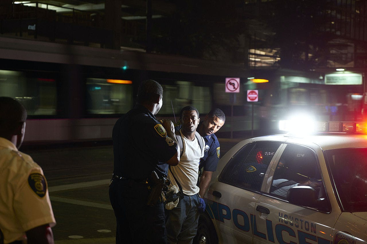 Houston Police arresting young man 5 reasons cops want to legalize recreational marijuana too