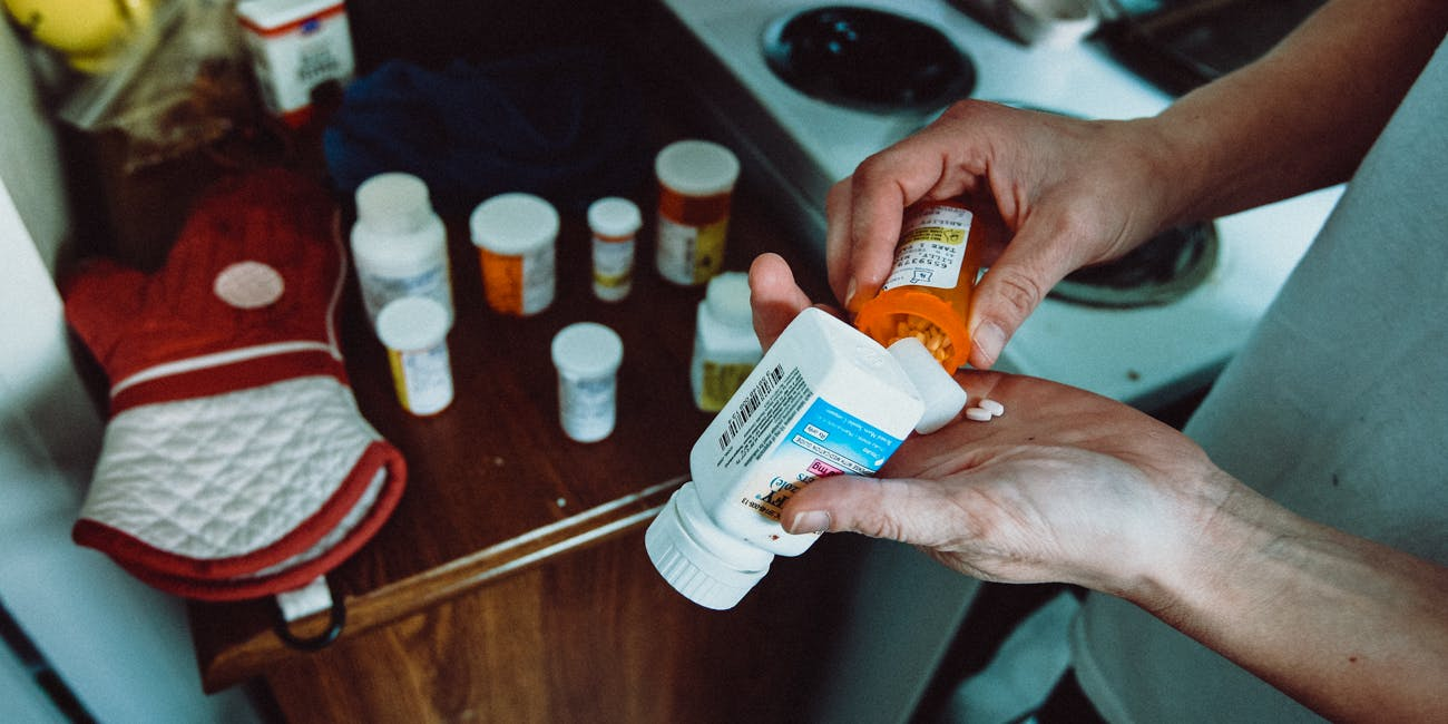 Woman with anxiety medication in hands
