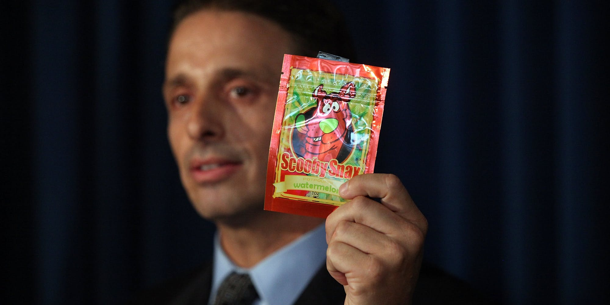 Kieth Kruskall with the Drug Enforcement Administration, holds up a package of synthetic marijuana