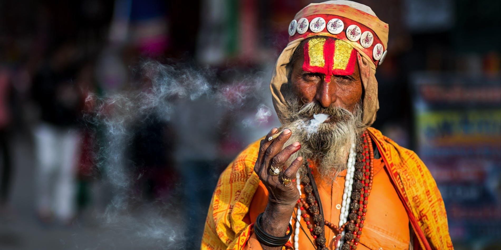 An Indian baba having a smoke of Hindu Kush