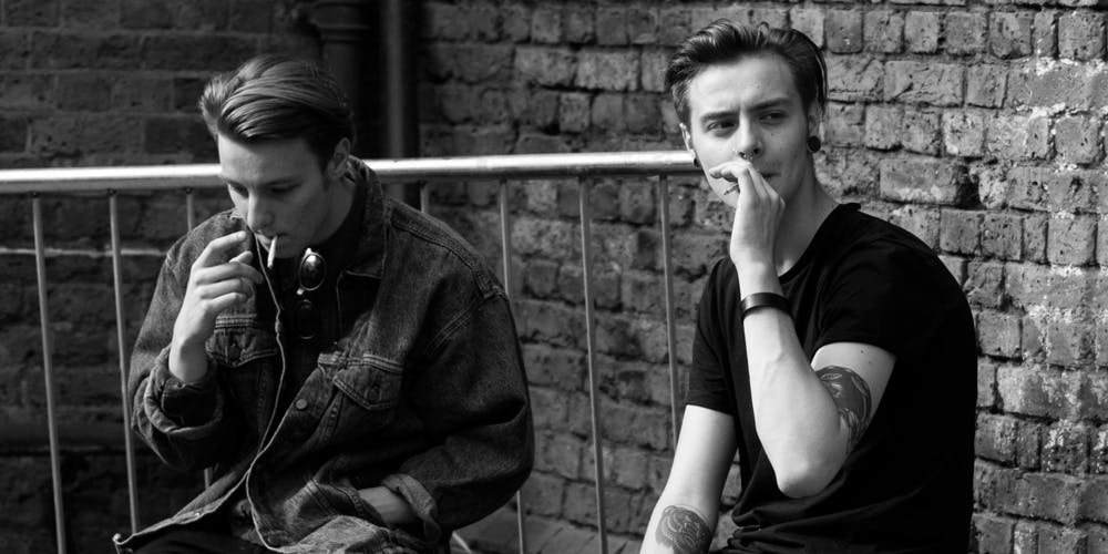 Two young males smoking