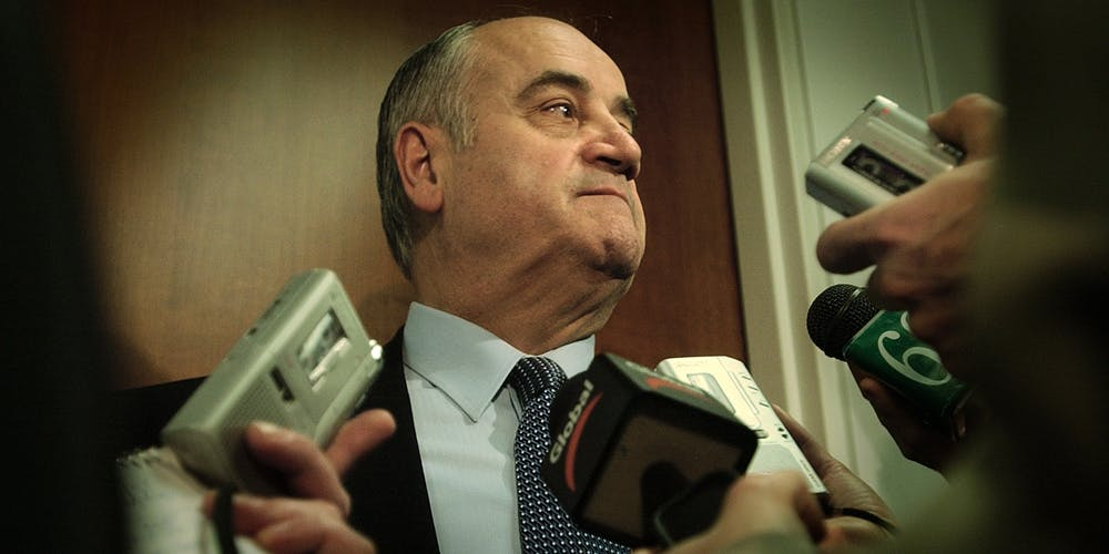 Julian Fantino with a lot of mics held up to his face