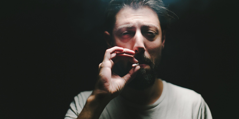 Close-Up Of Man Smoking a joint