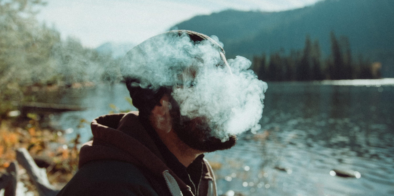 Man smoking cannabis with the polar blast on an ice cold mountain