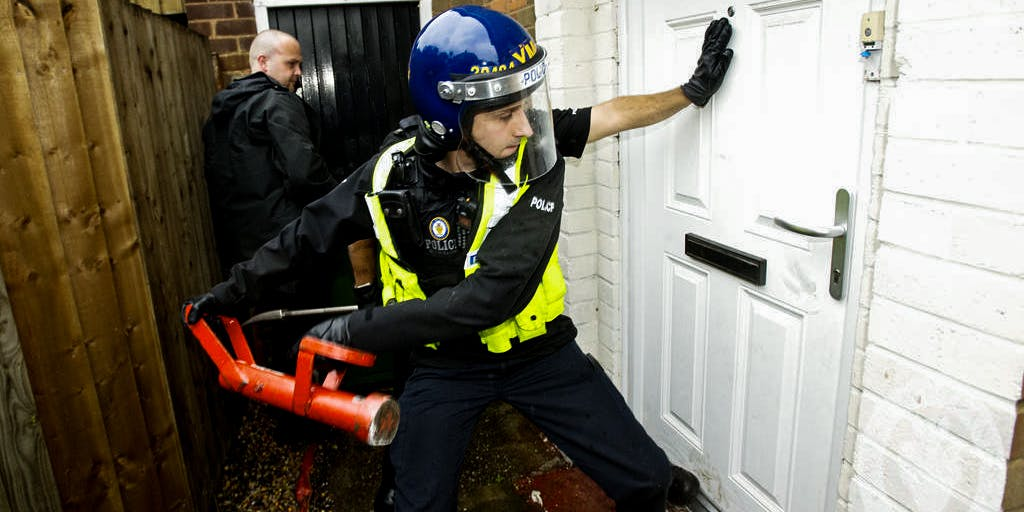 Police raiding a house