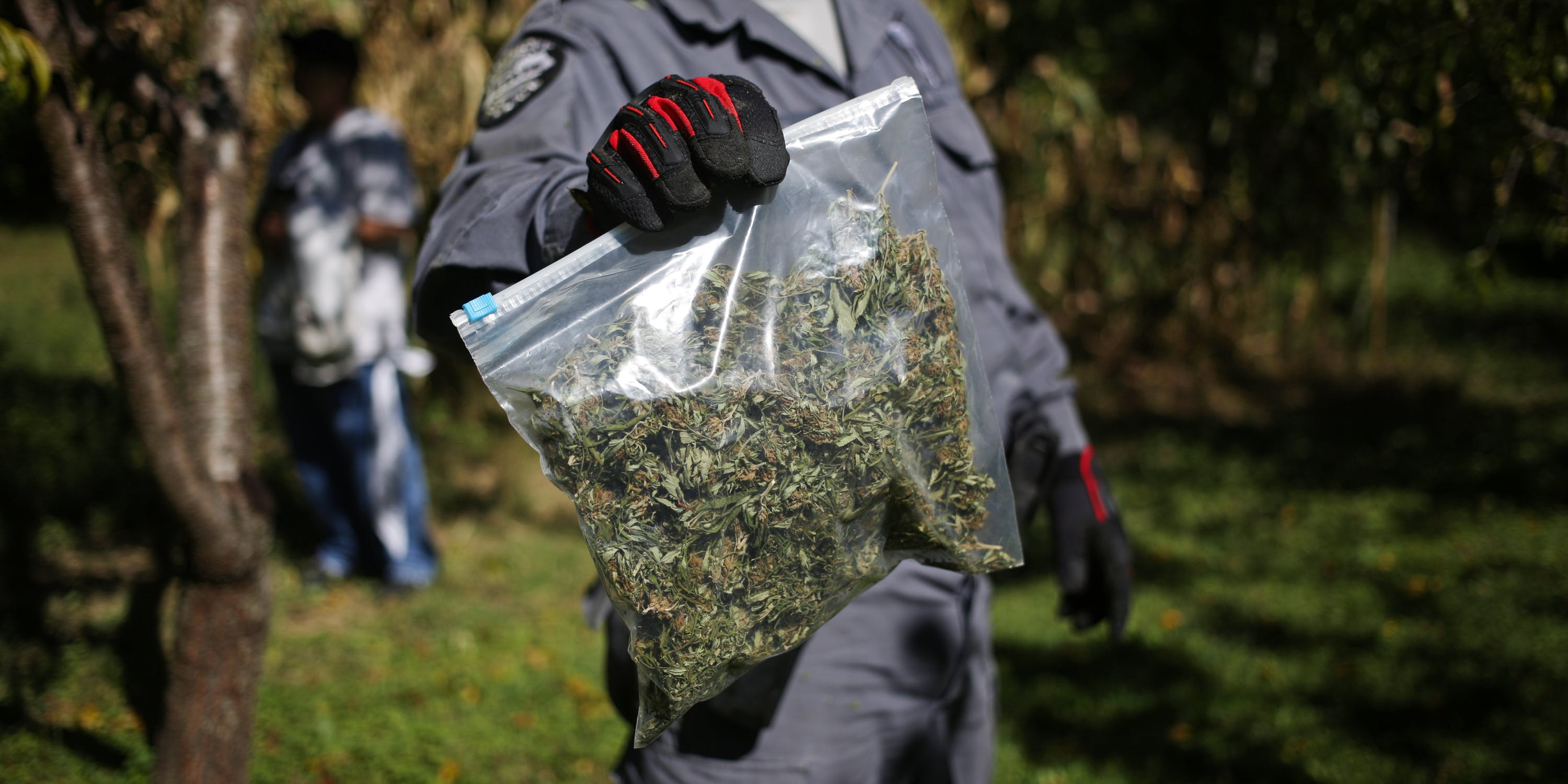police officer with a bag of marijuana