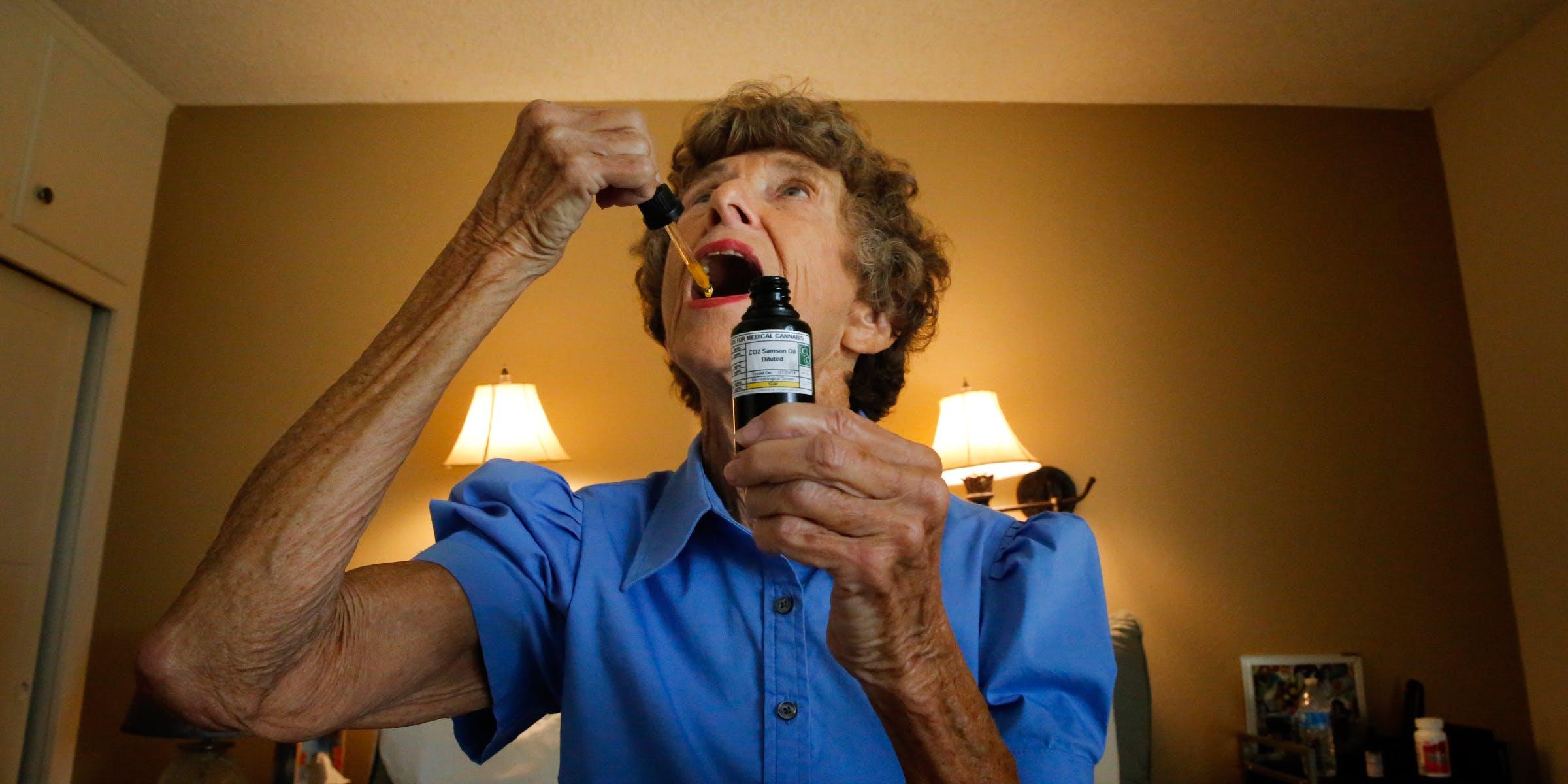 Old women taking CBD Oil cannabis for seniors