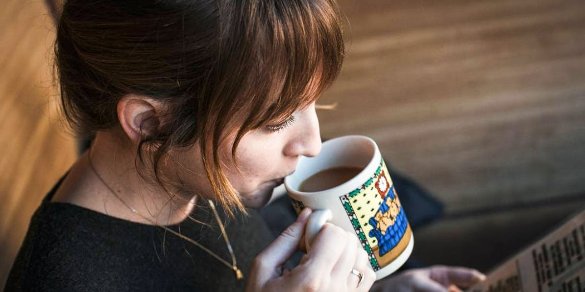 Women drinking a weed infused cup of coffee
