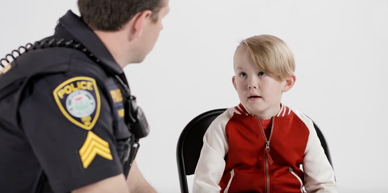 police talking to a little boy