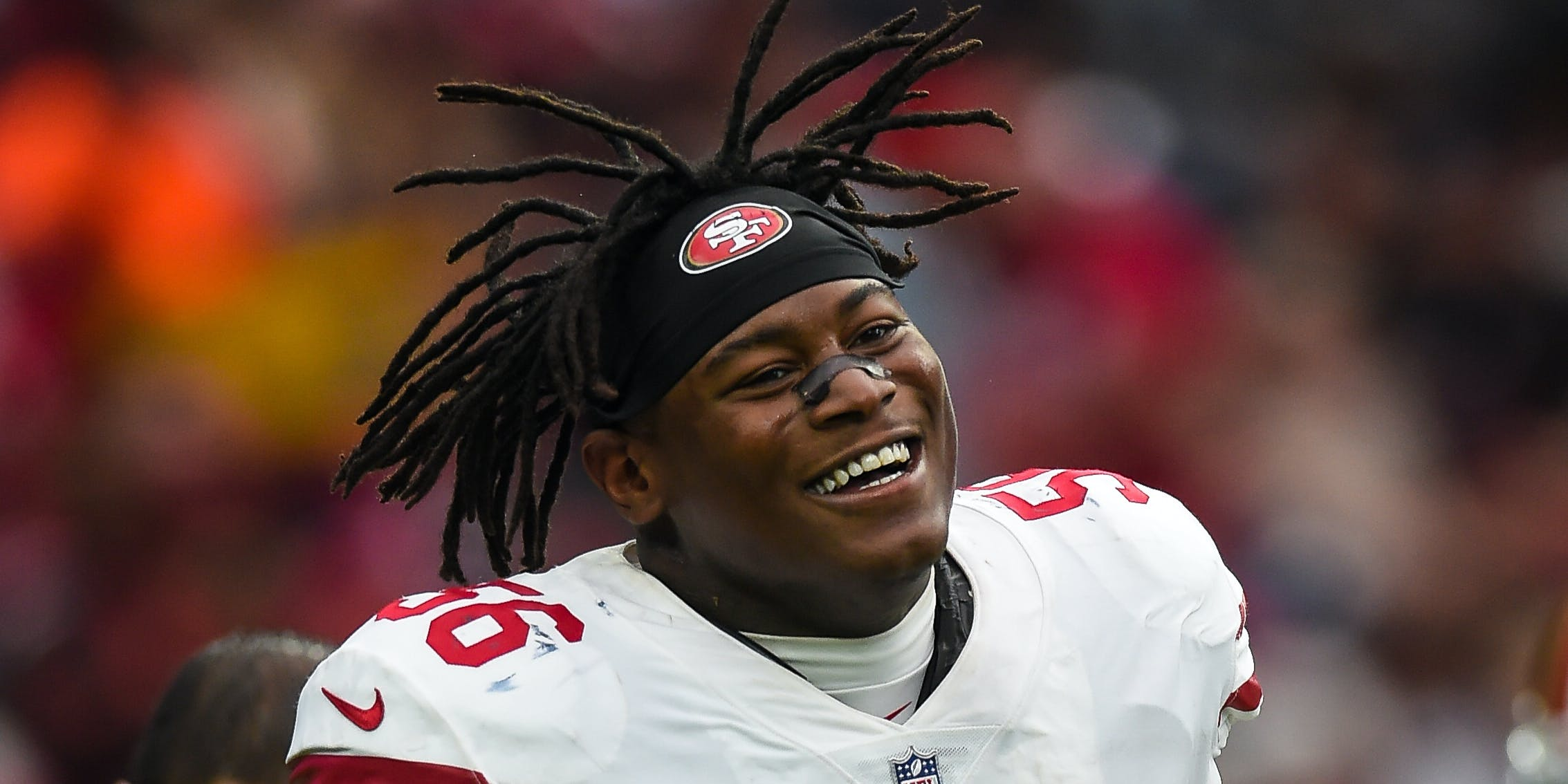 Reuben Foster of the San Fransisco 49ers smiling during a game