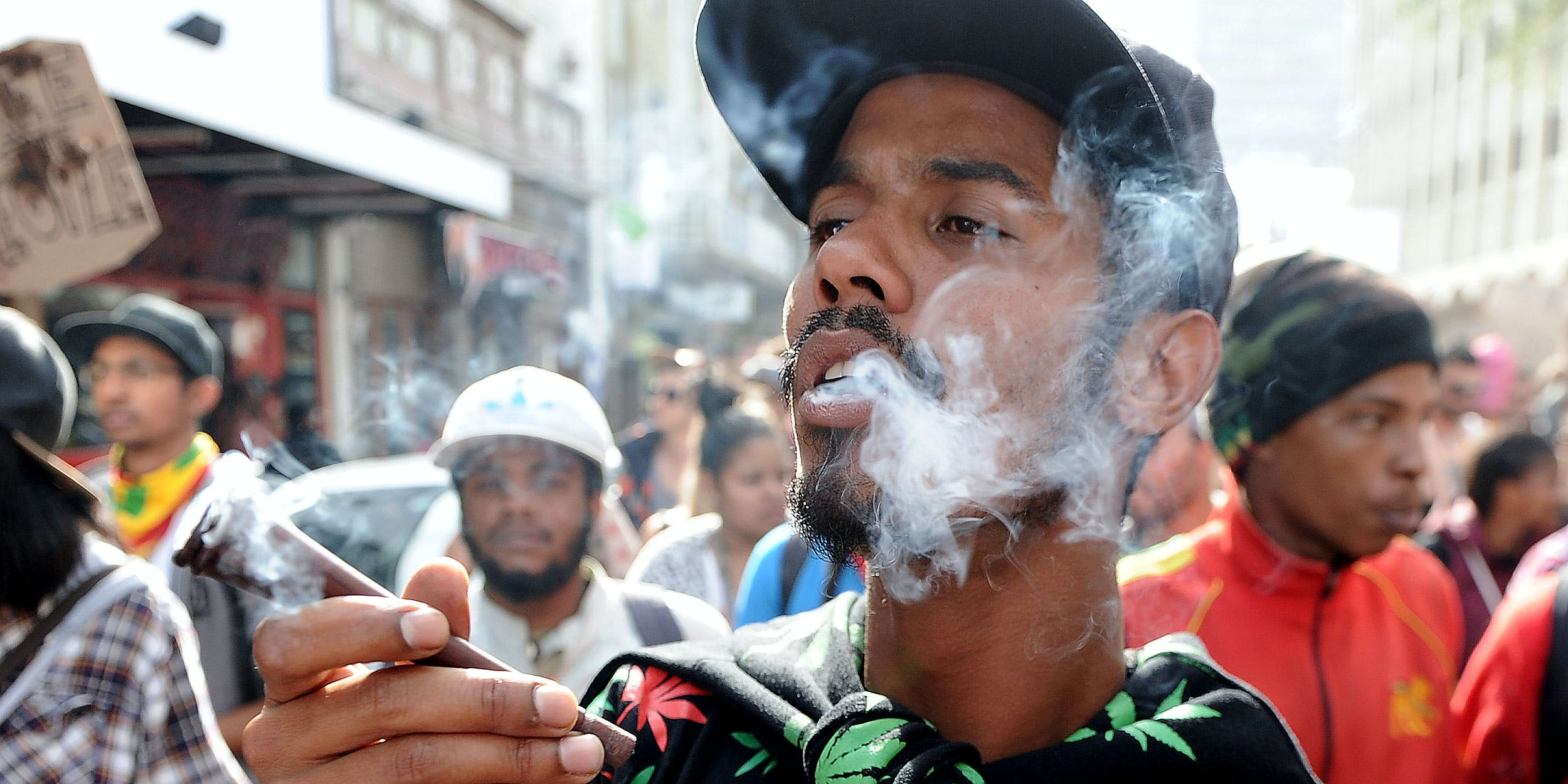 a man smokes marijuana during a marijuana march. Africa's first medical marijuana dispensary is about to open in South Africa.