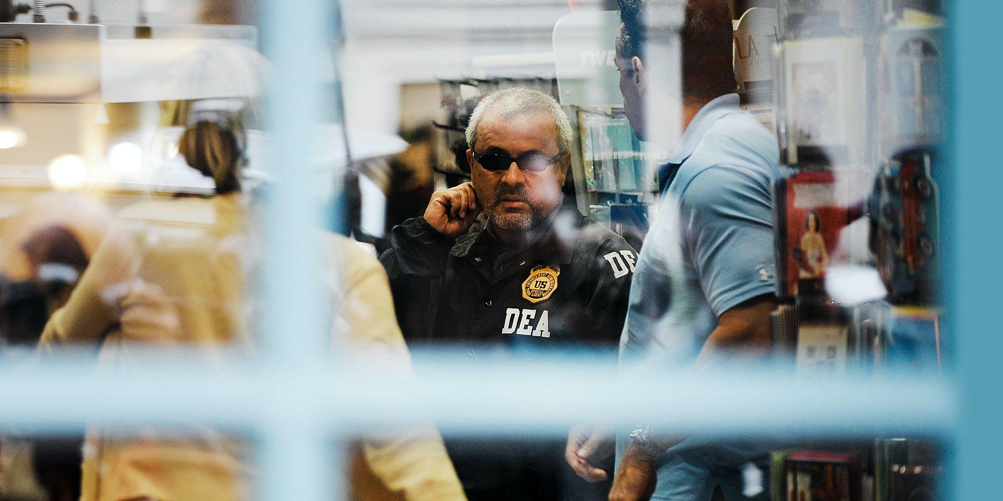 DEA agent speaking on phone