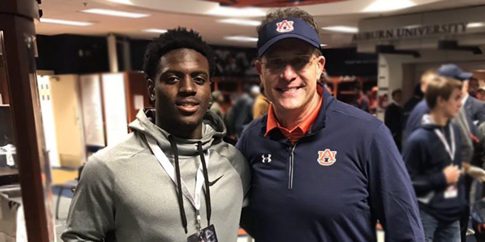 CJ Harris posing with Auburn Head Coach Gus Malzahn