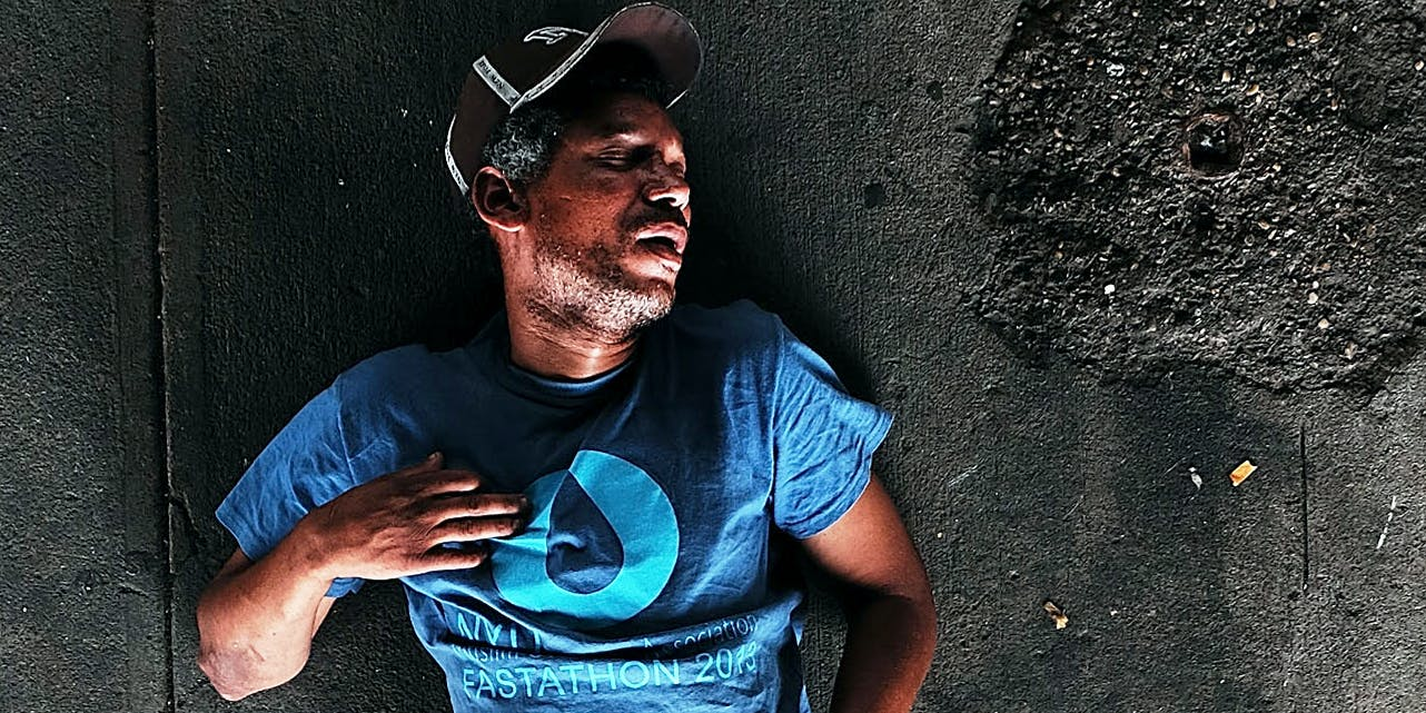 A passed out man lies on a sidewalk in an area which has witnessed an explosion in the use of K2 or 'Spice', a synthetic marijuana drug
