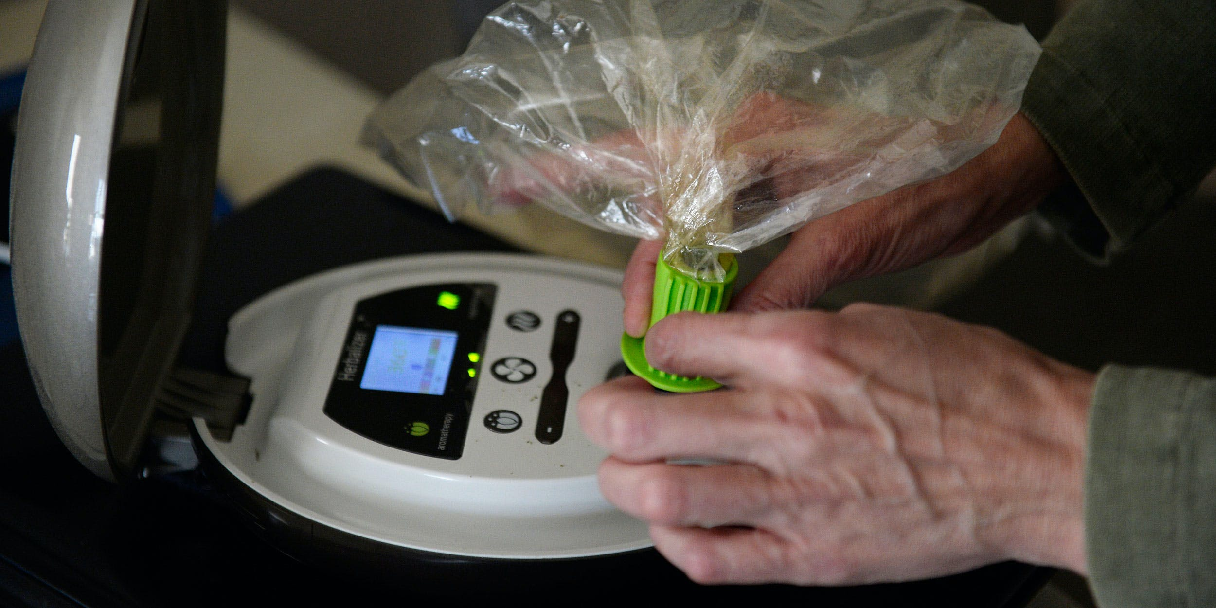 woman uses a herbalizer to fill a bag with cannabinoid vapor. Now Jefferson University is creating the larges medical marijuana patient database ever.