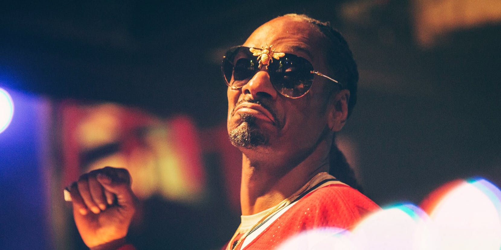 Snoop Dogg wearing a Montreal Canadiens jersey while in Quebec.