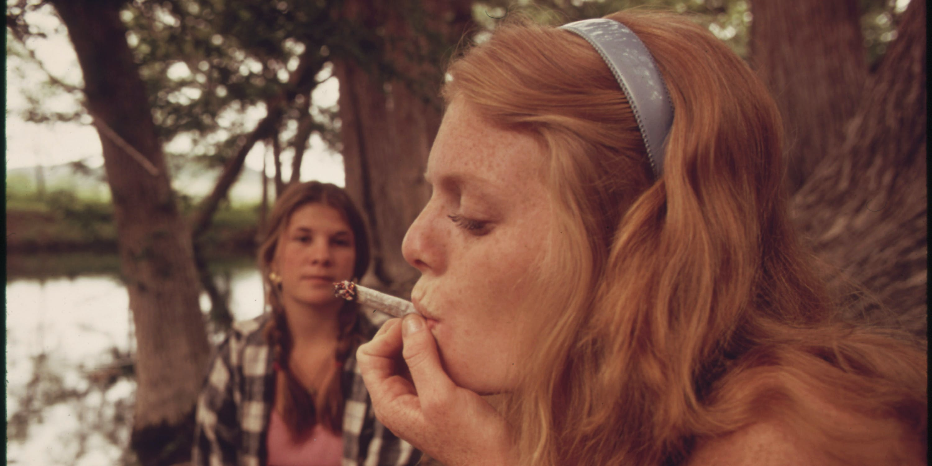 One Girl Smokes Pot While Her Friend Watches