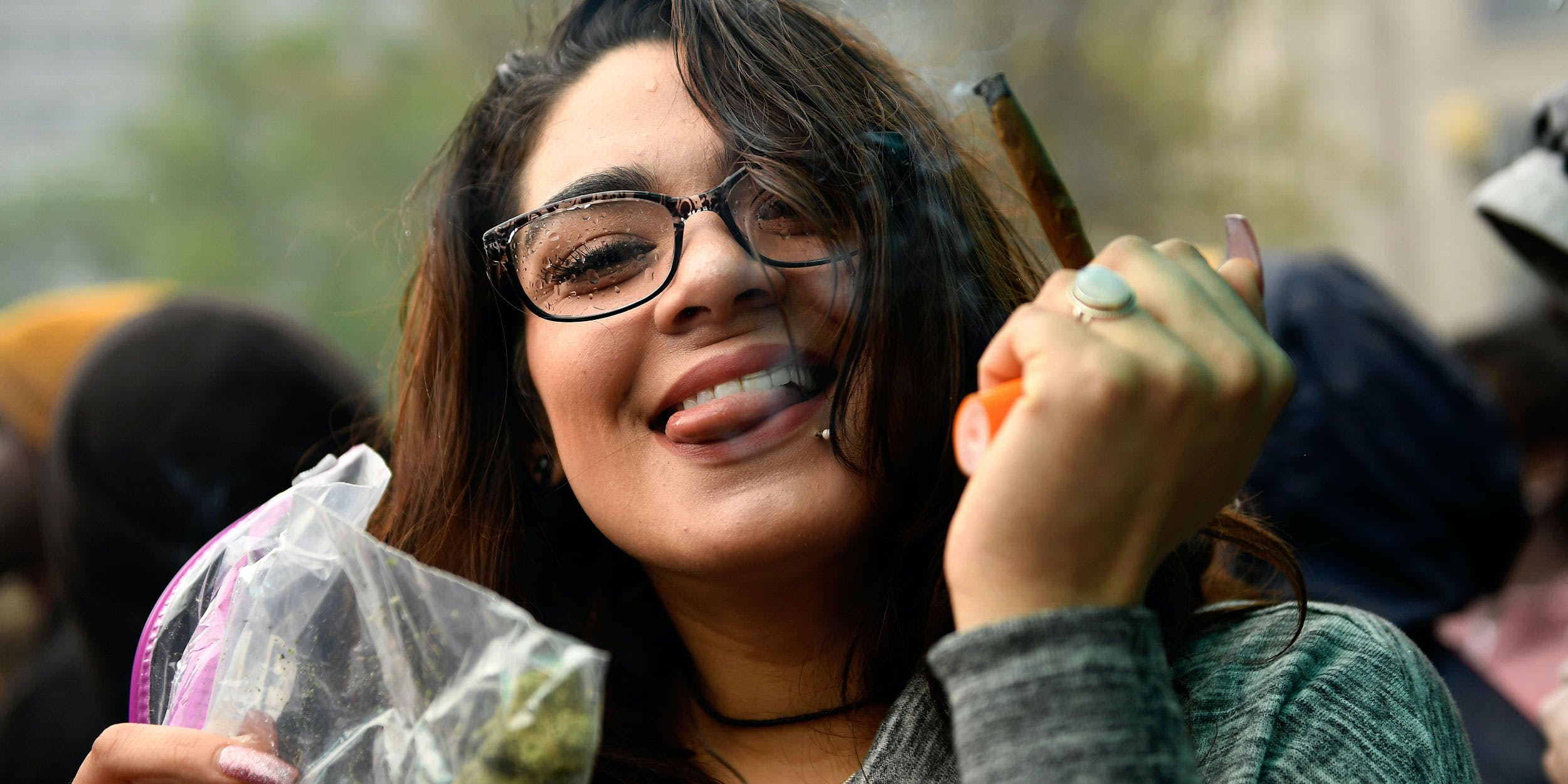 Alexus Alcala of Denver happy and still smoking after the 420 countdown in the rain at the Denver 420 Rally at Civic Center Park in downtown Denver on April 20, 2017. The state's recreational market is only six years old and the cannabis industry already has an influential political lobby.