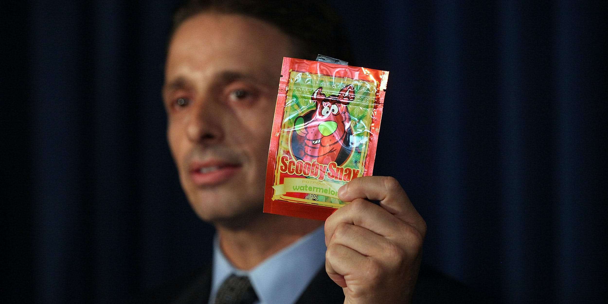 Kieth Kruskall with the Drug Enforcement Administration, holds up a package of synthetic cannabis