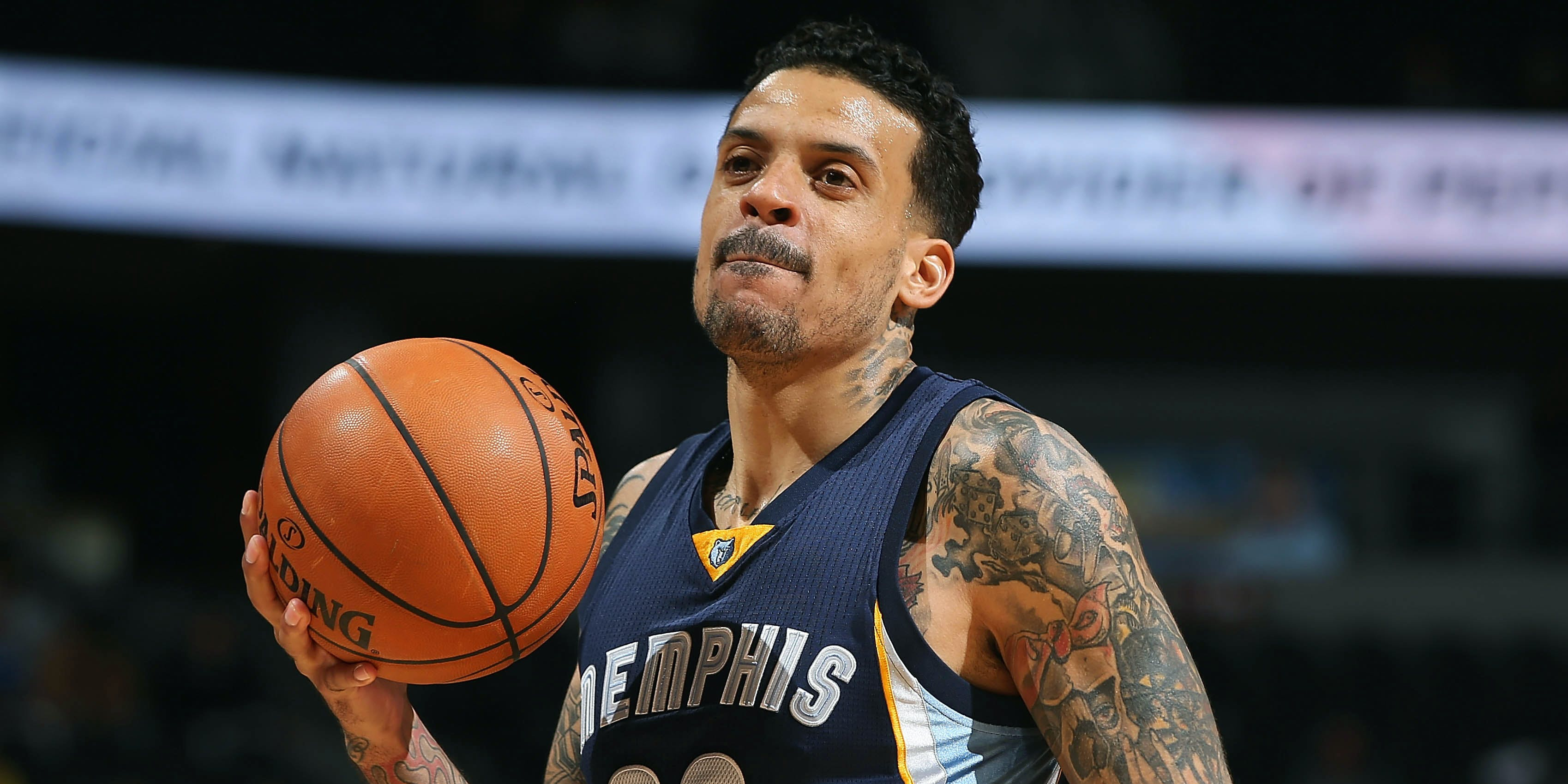 Matt Barnes holding a basketball and licking his lips while playing for the Grizzlies