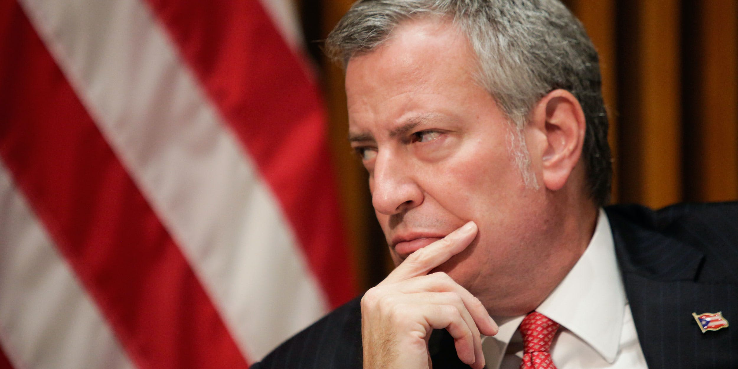 New York City Mayor Bill de Blasio listens to a question