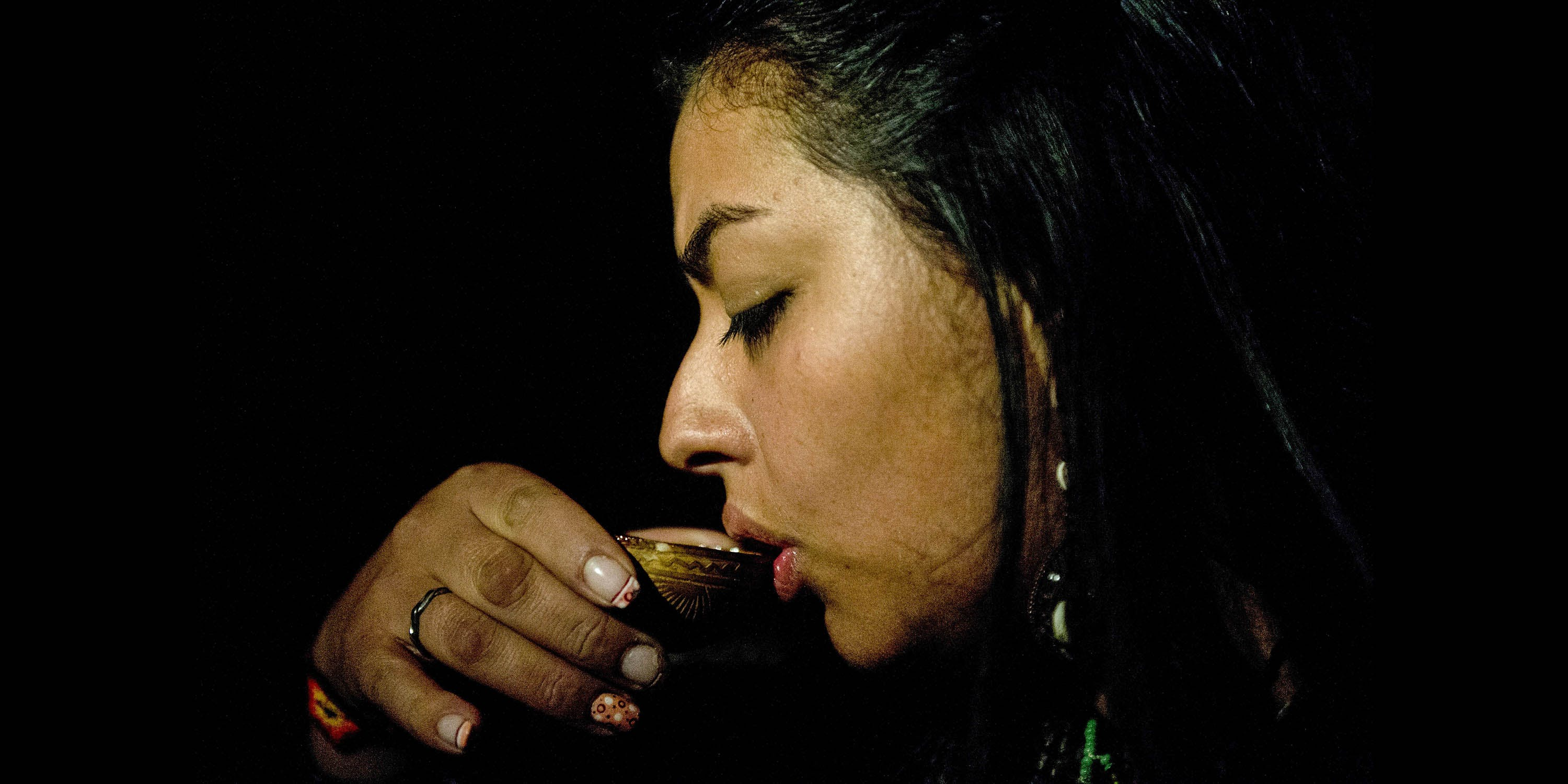 woman drinking ayahuasca
