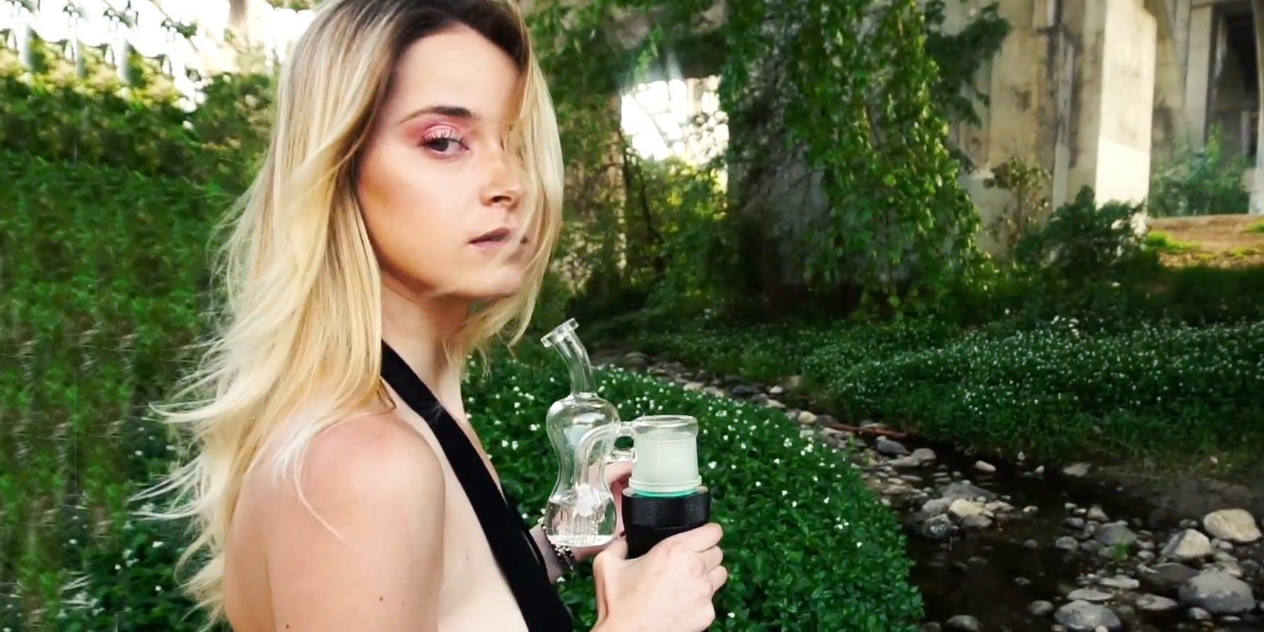 A woman enjoys the perks of erigs and dabs on the go