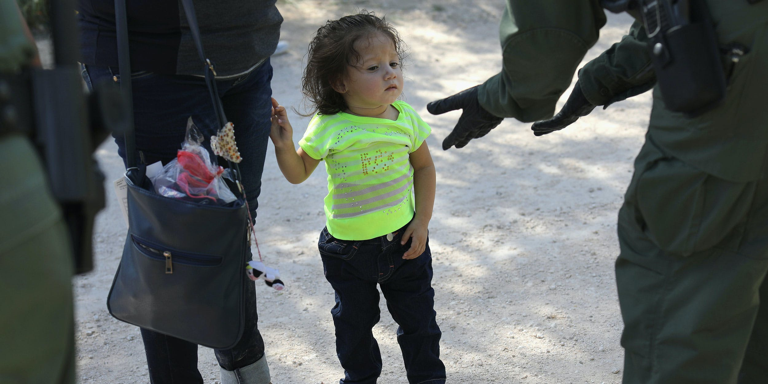 U.S. Border Patrol agents take Central American asylum seekers into custody on June 12, 2018 near McAllen, Texas. The immigrant families were then sent to a U.S. Customs and Border Protection (CBP) processing center for possible separation. U.S. border authorities are executing the Trump administration's zero tolerance policy towards undocumented migrants. (Photo by John Moore/Getty Images)