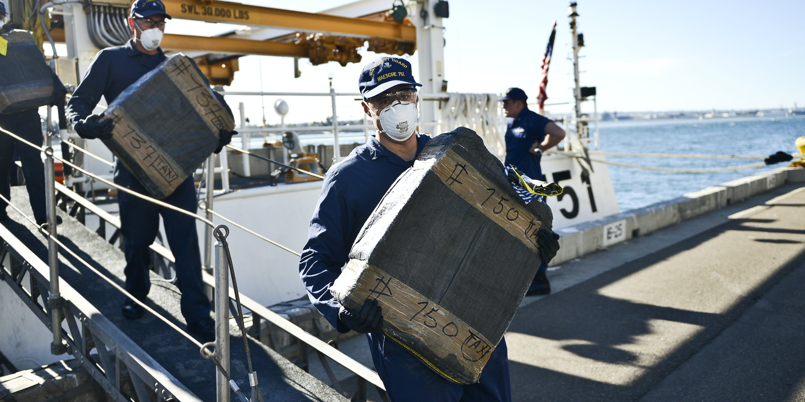 Crews from the U.S. Coast Guard Cutter Waesche offload nearly 660 kilograms of narcotics in 2015. Nearly 500 pounds of cannabis, $6000, and a gun were recently seized during the arrest of two individuals trying to illegally cross the border off Florida's coastline.