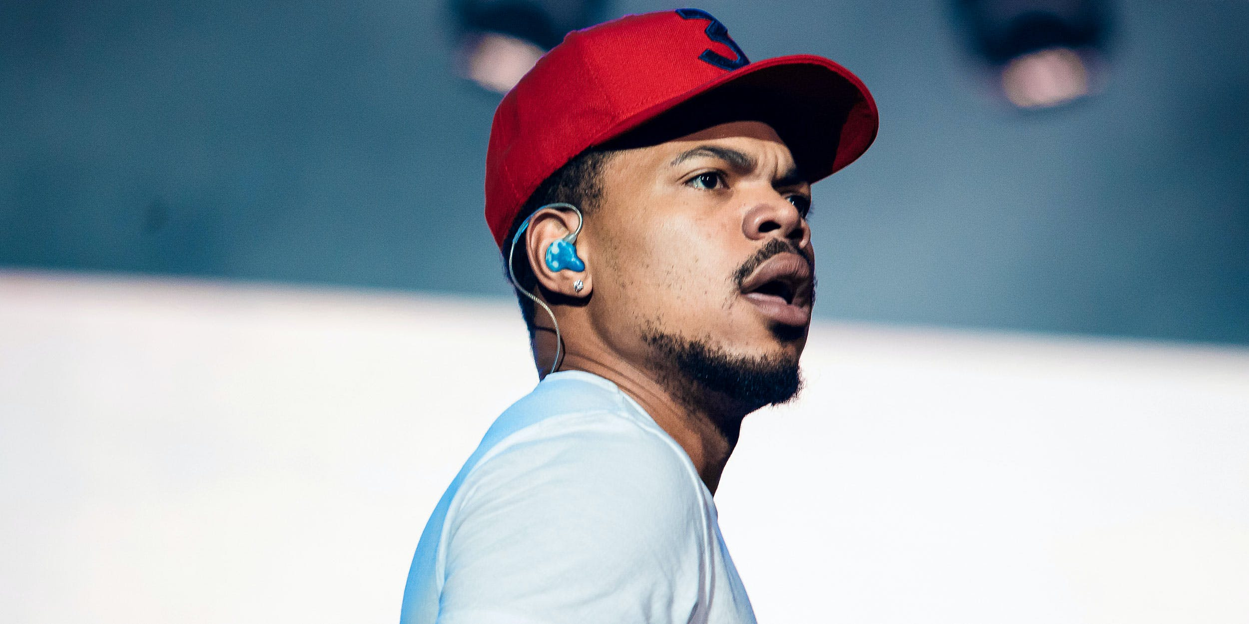 Chance the Rapper looks out at a crowd from the Lollapalooza stage in Brazil in March. Now he has his sight set on two new collaboration albums with Kanye West and Childish Gambino.