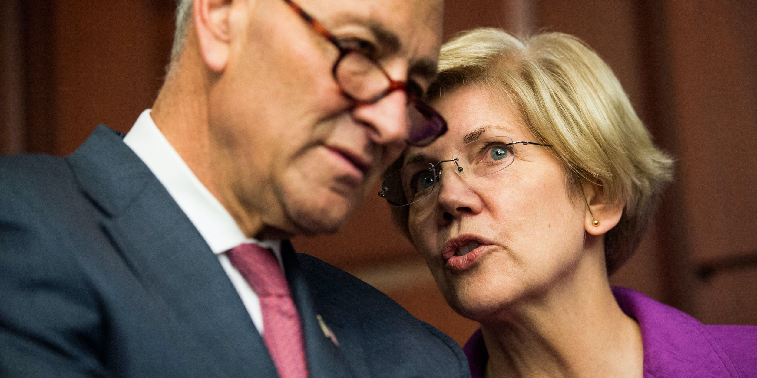 From left, Sen. Chuck Schumer, D-N.Y., and Sen. Elizabeth Warren, D-Mass., talk during the Senate Democrats' news conference on Tuesday, July 21, 2015. They've both been crucial to the marijuana legalization movement.