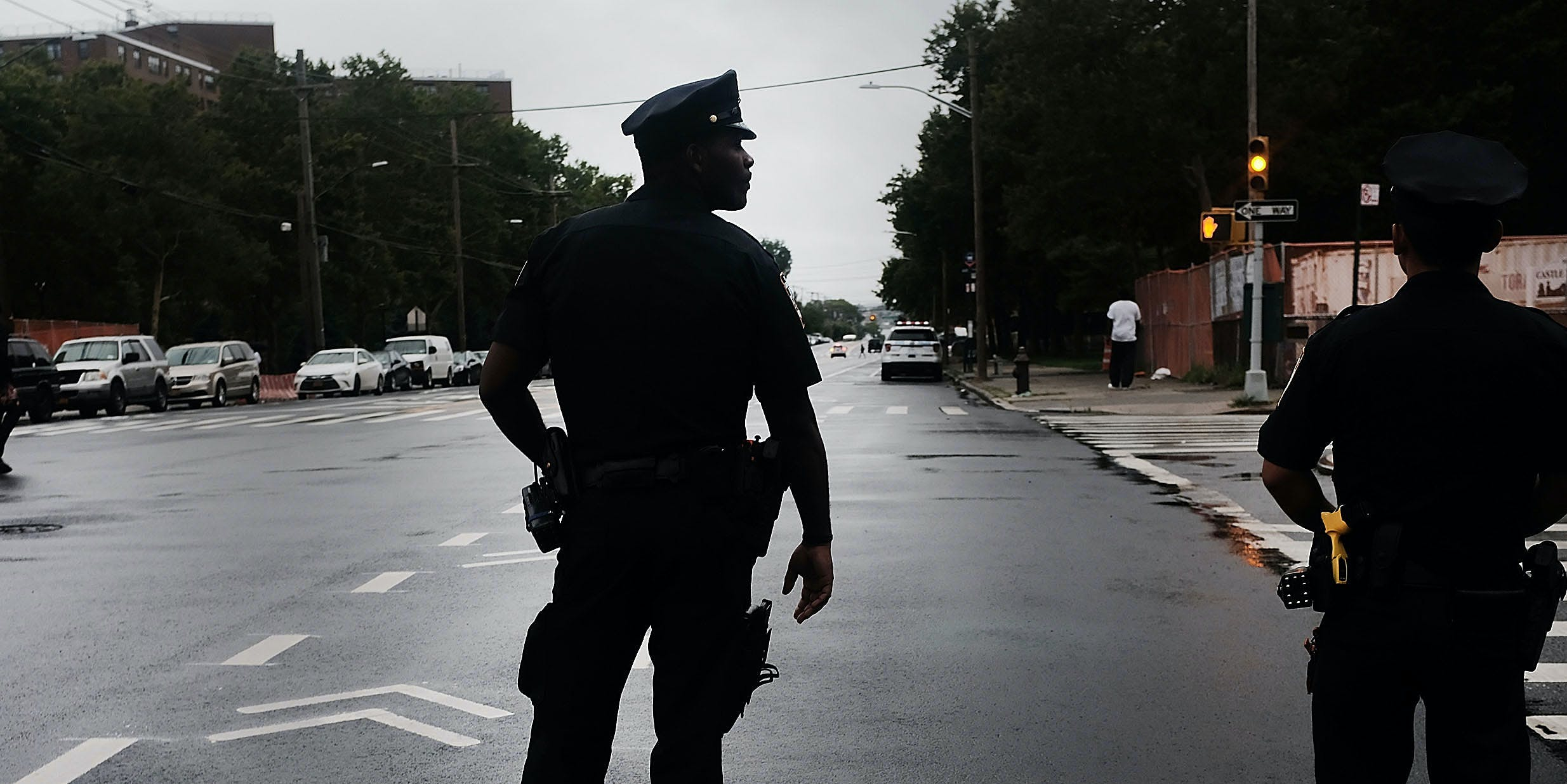 A police officer stands on patrol as people participate in a Silent Peace March against Violence in the Bronx on July 25, 2018 in New York City. A recent study found cannabis legalization does not lead to an increase in felonies in Washington