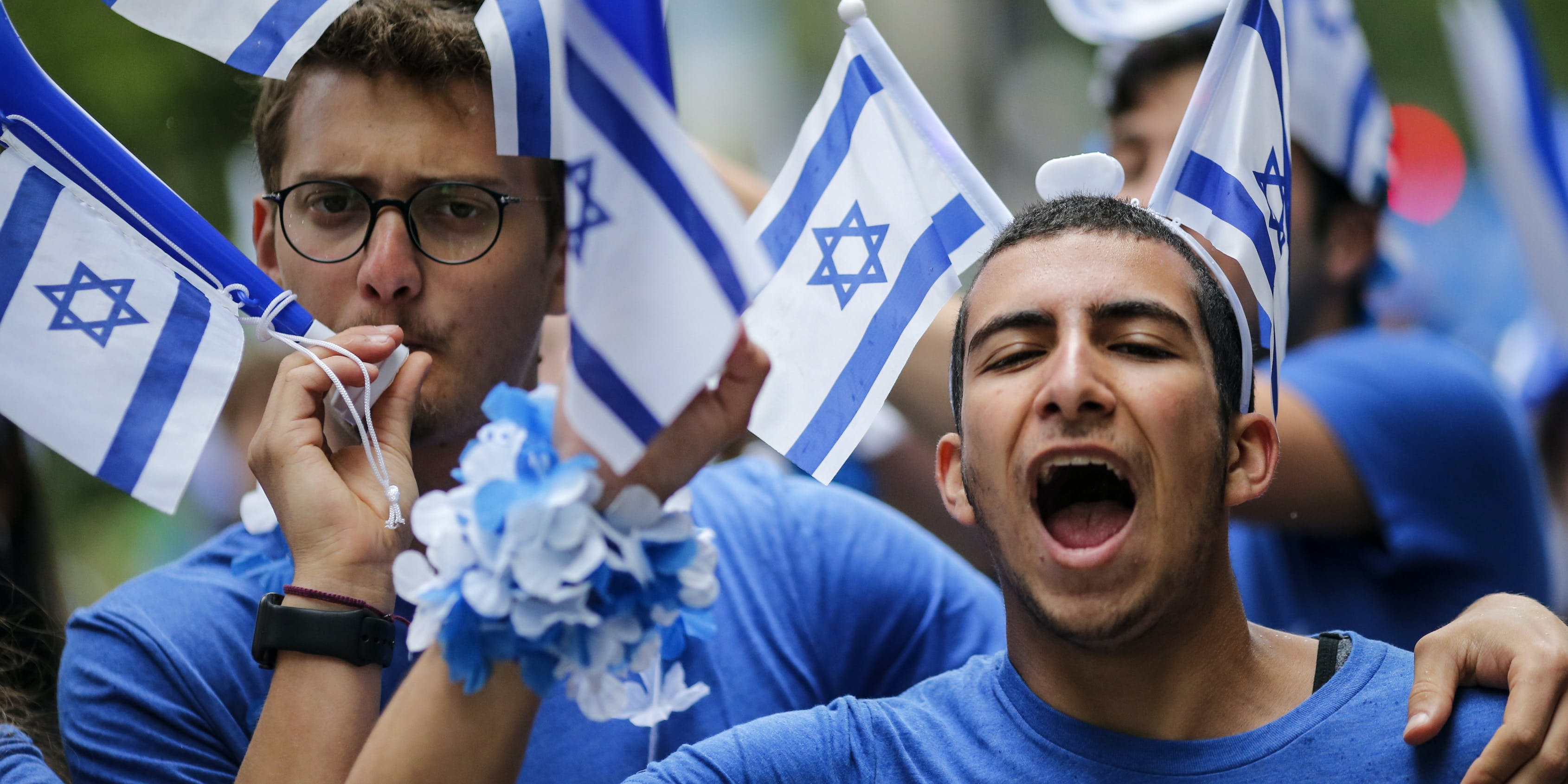 NEW YORK, NY - JUNE 03: People participate in the annual Celebrate Israel Parade on June 3, 2018 in New York City. Security will be tight for the parade which marks the 70th anniversary of the founding of Israel. (Photo by Kena Betancur/Getty Images)