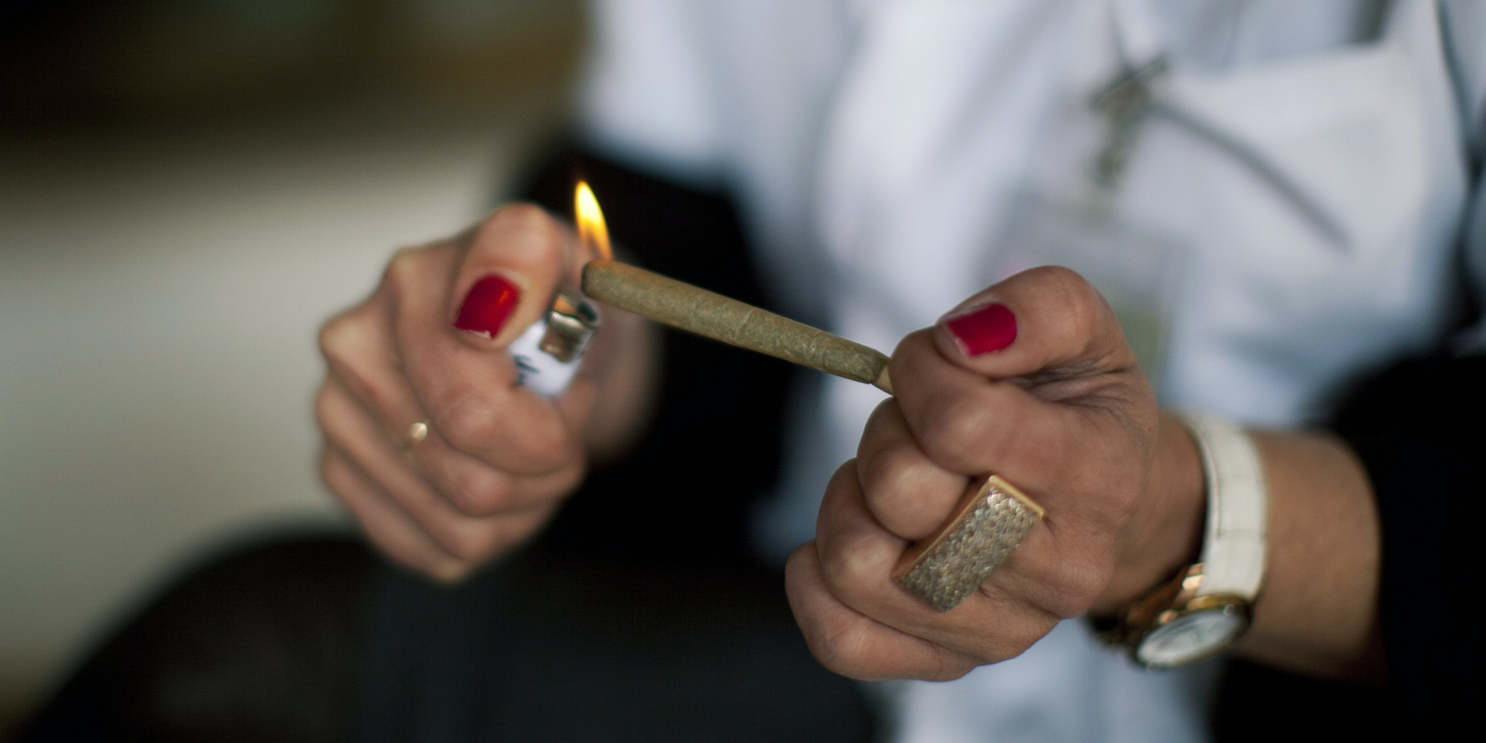 KIBUTZ NAAN, ISRAEL - MARCH 09: A nurse lights a cannabis cigarette for a patient at the Hadarim nursing home, on March 09, 2011 in Kibutz Naan, Israel. NiaMedic just announced it will bring the first clinic like it to America (Photo by Uriel Sinai/Getty Images)